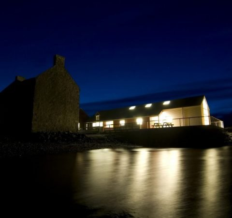taigh chearsabhagh museum & arts centre studios at night with high tide